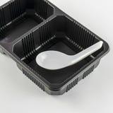 Black tray with spoon Stock Photo