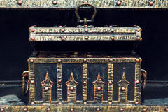Black Treasure chest with gold metal old forged. Treasure chest with gold metal old forged stock photo