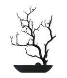 Black tree. Black potted tree with burnt wood Royalty Free Stock Photography