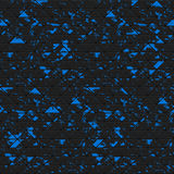 Black triangles of metal, stone with blue spots.  Stock Image