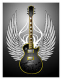 Black Tribal Guitar w/Wings. Black tribal electric guitar with a pair of wings and a big tribal on the background Royalty Free Stock Photo