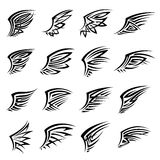 Black tribal isolated wings icons or tattoos Royalty Free Stock Photos