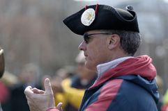 Black Tricorn Hat. Boston, Massachusetts USA - April 2013 - Man wearing black Tricorn hat and clapping while listening to speakers at the Boston Tea Party rally Royalty Free Stock Photography