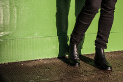 Black trousers and ladies vintage boots. Model wearing black trousers and ladies vintage boots with low heel (short Chelsea ankle) on the street Royalty Free Stock Image