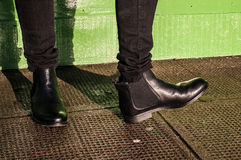 Black trousers and ladies vintage boots. Model wearing black trousers and ladies vintage boots with low heel (short Chelsea ankle) on the street Stock Image