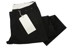 Black trousers with tagging. Isolated Royalty Free Stock Images