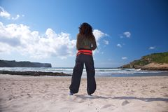 Black trousers woman. Algaiarens beach at Menorca island in Spain royalty free stock photography