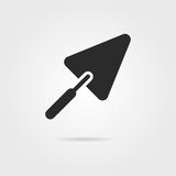 Black trowel icon with shadow. Concept of implement, workshop, household, create, major overhaul, roughcast. isolated on gray background. flat style trend Stock Photo