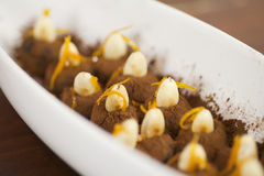 Black truffels with almond and orange peel Royalty Free Stock Photo