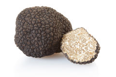 Black truffle and half on white Royalty Free Stock Images