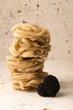 Black Truffle and Pasta Stack Royalty Free Stock Image