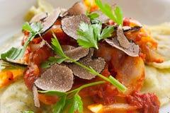 Black truffle ravioli pasta Stock Image