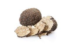 Black truffle and slices on white Stock Image