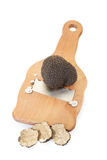 Black truffle, slices and wooden truffle slicer royalty free stock image