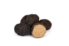 Black truffles. Black autumn truffles from France on a white background - tuber uncinatum stock photo