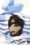 Black Truffles on checkered dish cloth Stock Image