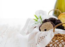 Black truffles in golden basket Stock Photos
