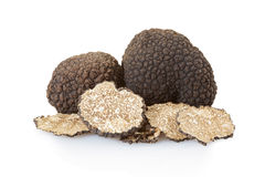 Black truffles group and slices on white Royalty Free Stock Photos