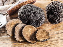 Black truffles. Black truffles on the old wooden table royalty free stock photo