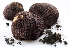 Black truffles with the pieces of soil Stock Photography