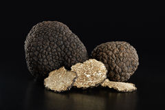 Black truffles and slices on black. Clipping path included Royalty Free Stock Photography