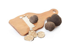 Black truffles, slices and wooden truffle slicer. Isolated on white, clipping path included royalty free stock photo