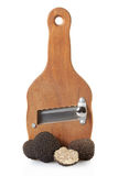 Black truffles and wooden truffle slicer royalty free stock photography