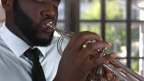 Black trumpet player. Musician with closed eyes stock footage