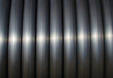 Black tubes. Close up photo of shiny black tubes royalty free stock photography
