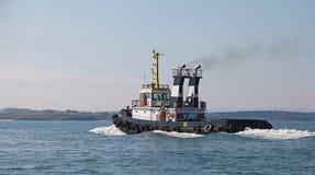 Black tug is underway, Black sea, Bulgaria Stock Photos