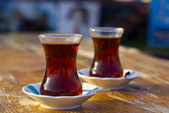 Black turkish tea in the traditional glass on the table Stock Photos