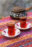 Black tea in traditional Turkish glasses Stock Photos