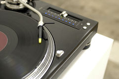 Black Turntable and record. A spinning record on a DJ turntable Stock Photography