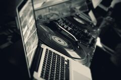 Black Turntable Beside White Laptop Computer Royalty Free Stock Images