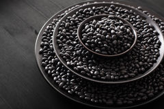 Black turtle beans legumes in bowls Royalty Free Stock Image