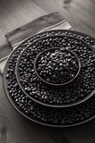 Black turtle beans legumes in bowls Royalty Free Stock Photo
