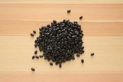 Black turtle beans on wood Stock Photos