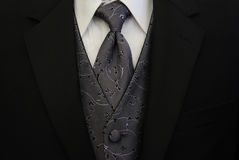 Black Tuxedo Silver Tie and Vest. A close up of a black pin-striped tuxedo jacket with a silver tie and vest Stock Photo