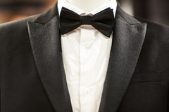 Black tuxedo and tie on mannequin. Wedding black tuxedo and tie  on the unrecognizable person Stock Photography