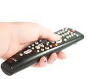Black TV remote control in hand Royalty Free Stock Image