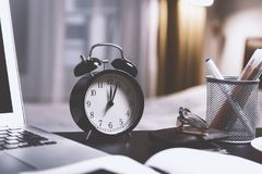 Black Twin Bell Alarm Desk Clock on Table royalty free stock photography