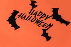 Black logo of Halloween and black bats painted on orange background Royalty Free Stock Photo