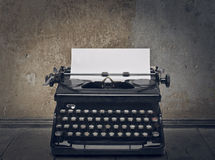 Typewriter. Black typewriter with white paper in the street royalty free stock photos