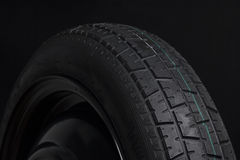 Black Tyre in Black background Stock Photos