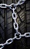 Black tyre with chain Royalty Free Stock Image