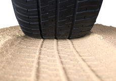 Black tyre and track on sand Stock Photo