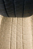 Black tyre and track on sand Royalty Free Stock Photo