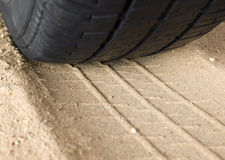 Black tyre and track on sand Royalty Free Stock Photos