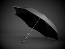 Black umbrella with dark background Royalty Free Stock Photo