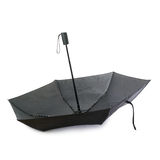 Black umbrella isolated over the white background Royalty Free Stock Image